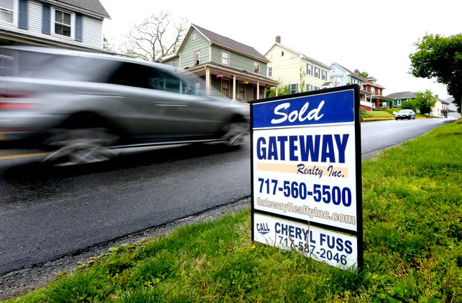 """A """"sold"""" sign is posted at a home on Main Street in Shrewsbury Sunday, May 9, 2021. Bill Kalina photo"""