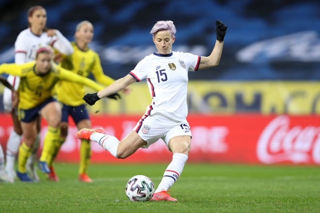 Megan Rapinoe of the United States, seen here scoring the team's first goal from a penalty kick during an international friendly between Sweden and the U.S. on April 10, will be in Austin on June 16 to lead the USWNT in a match against Nigeria at Q2 Stadium.