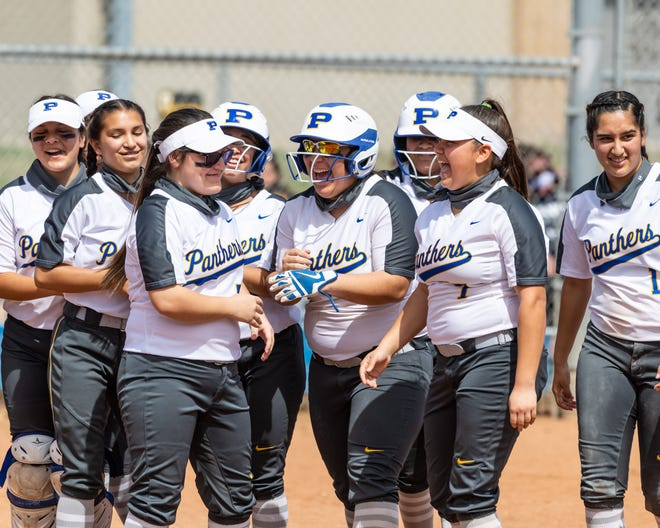 """Catcher Elia Palomo celebrates with her Pflugerville teammates during a win over Hendrickson earlier this season. The Panthers lost to Waller in the second round of the playoffs this past weekend, but first-year coach Matt Peterson says """"we're a young team. ... Pflugerville High School softball has a very bright future, and I'm just happy I'm along for the ride."""""""