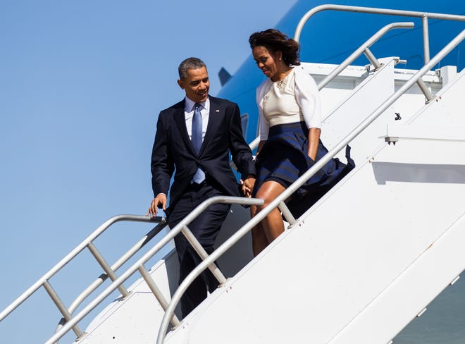 First lady Michelle Obama and President Barack Obama arrive at Austin-Bergstrom International Airport on Air Force One, April 10, 2014, in Austin. (RICARDO B. BRAZZIELL / AMERICAN- STATESMAN)