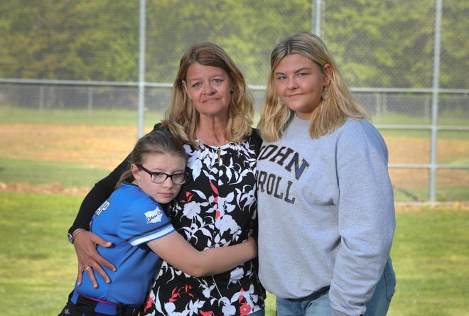 From left, Camille Dunlap, Julie Wallace and Mallory Dunlap. Julie's longtime partner and the girls' father, Lewis Dunlap, died on Nov. 29 due to complications from COVID-19.