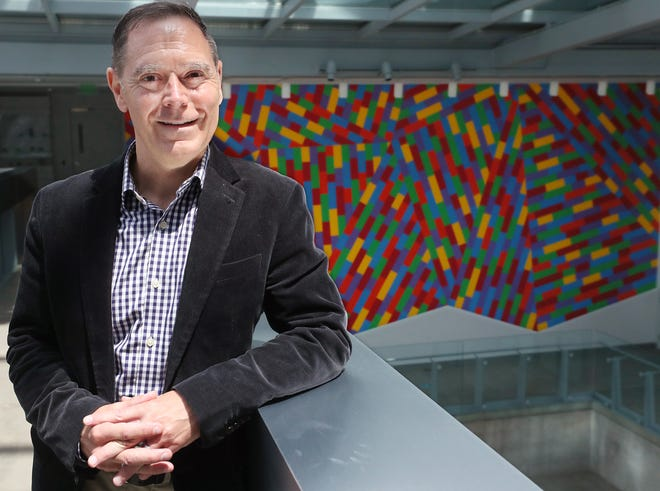 Jon Fiume, interim executive director of the Akron Art Museum, has had his contract extended for two years.