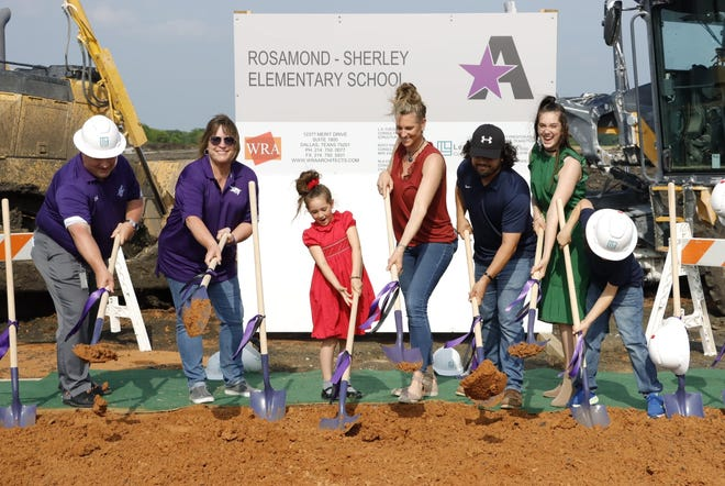 Anna ISD Superintendent Michael Comeaux, Board President Shelli Conway and members of the Sherley family break ground on Rosamond-Sherley Elementary School.