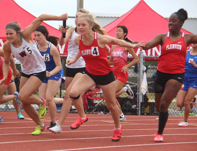 Plainview's Molly Harlow, center, receives the baton from Eshaya Lewis earlier this season. The duo joined Kate Brown and Emily Hudson to finish third in the 4x100 relay at 50.89 on Saturday during the Class 4A State Championship.
