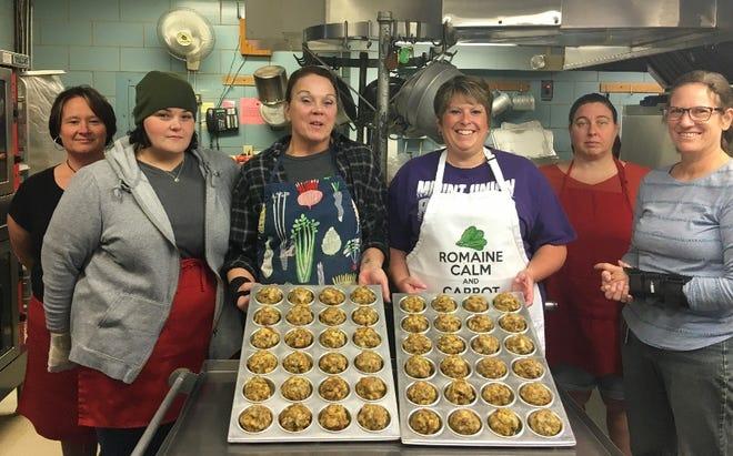 Cooks at Millersburg Elementary School, from left, are Geneva Knapp, Jamie Swartz, Lynn Roub, Dawn Martin, Susanne Jones and Tracy McCombs with stuffling balls from Martin's recipe scrapbook.