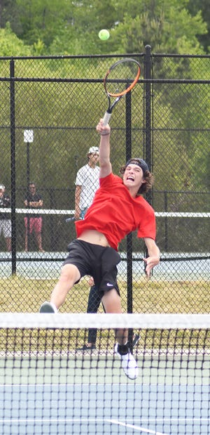 Screven County High School No. 1 singles player Attison Lee goes up high for a return shot May 8 in the Class A state championship match at Berry College in Rome. Lee won his first set in match, but was pulled when the Gamecocks fell 3-0 to Seminole County. See more about the state runner-up Gamecocks on page B1.