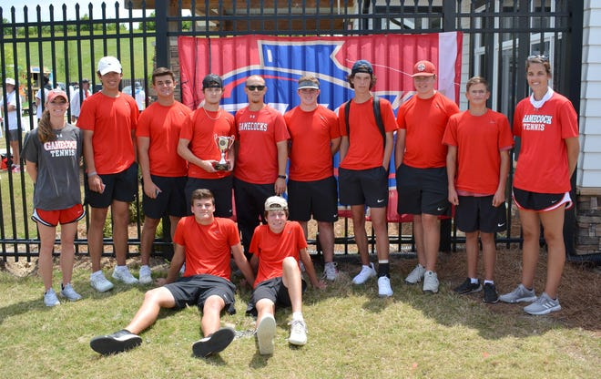 The Screven County High School boys tennis team with the coaches show the Class A state runner-up trophy at the Berry College Tennis Complex in Rome on May 8.
