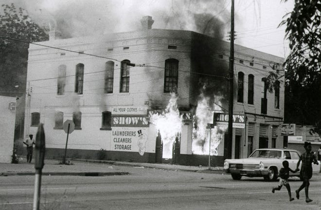 A building was set ablaze during a riot in Augusta on May 11, 1970. Six people were killed during the civil unrest.
