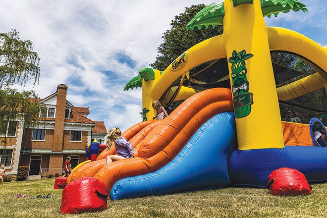 Children enjoy playing on the inflatables at the Frank Phillips Home on Saturday at the Family Fun Day presented by Arvest Bank.