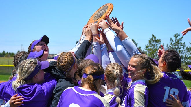 The Butler Grizzlies celebrating winning the 2021 Region VI Championships in Dodge City, Kansas on Saturday, May 9 after beating Barton.