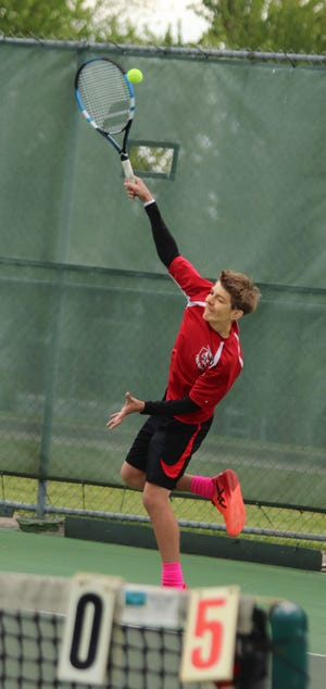 Chace Corbin, Chillicothe High School tennis Hornets junior, serves what would be the final, winning point of his 6-0, 6-0 victory in the singles quarterfinals of the Class 1 District 15 Tournament at Chillicothe's Daryl Danner Memorial Park courts last Saturday. Corbin went on to win the singles title, as seeded, not dropping a set on the day, as he advanced to sectional play, also at home, later this week.