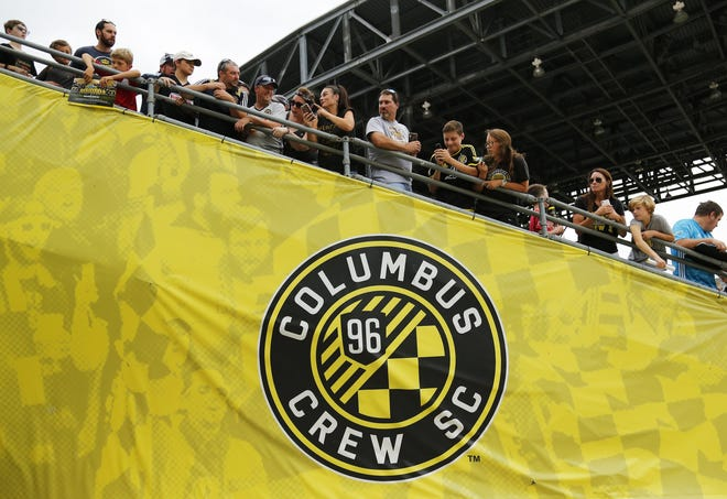 Fans stand above the now-former Crew logo as they await the team to take the field prior to a game in 2019.