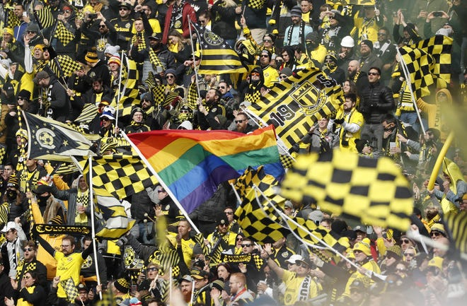 Crew fans celebrate during a match against New York City on March 1, 2020.