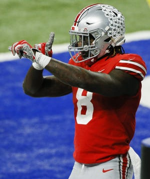 Ohio State running back Trey Sermon, here celebrating a touchdown against Northwestern in the Big Ten championship game, was elected by the San Francisco 49ers with the 88th pick in the NFL draft.