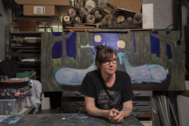 Mixed-media artist Kate Morgan in her studio in Columbus.