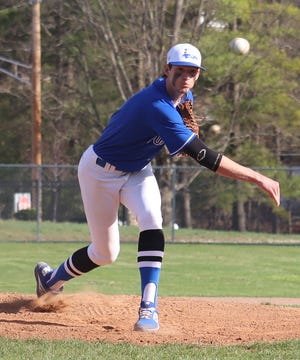Cambridge senior Sean Perkins (4) delivers a pitch during action earlier in the season.