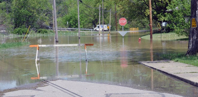 Water Street and parts of Main Street were underwater in Killbuck a day after heavy rains fell.