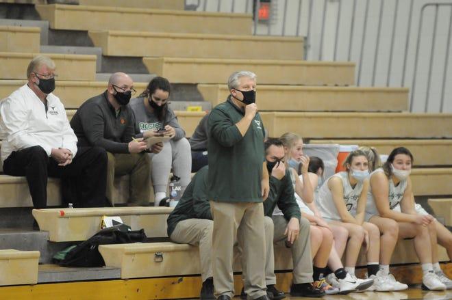 Sand Creek girls basketball coach Matt Benge looks on during a game in the 2021 season.
