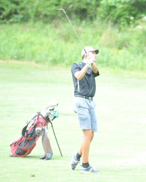 Oak Grove's Cayden Bryner hits on a fairway at Pinehurst No. 6 on Monday. [Mike Duprez/The Dispatch]