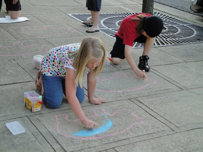 Children create sidewalk art with chalk during the 2019 Summer Stroll event sponsored by Uptown Lexington Inc. The chalk art contest is coming back, along with new features in the Summer Stroll lineup for 2021. COVID-19 prevented the Summer Strolls from happening in 2020.