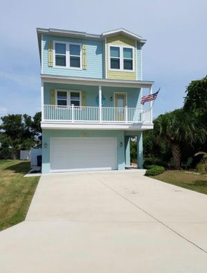 This upscale coastal-style home in Ormond Beach has an elevator to access its three levels.
