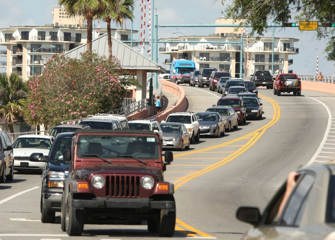Cars heading to New Smyrna Beach back up over the North Causeway bridge. (News-Journal file )