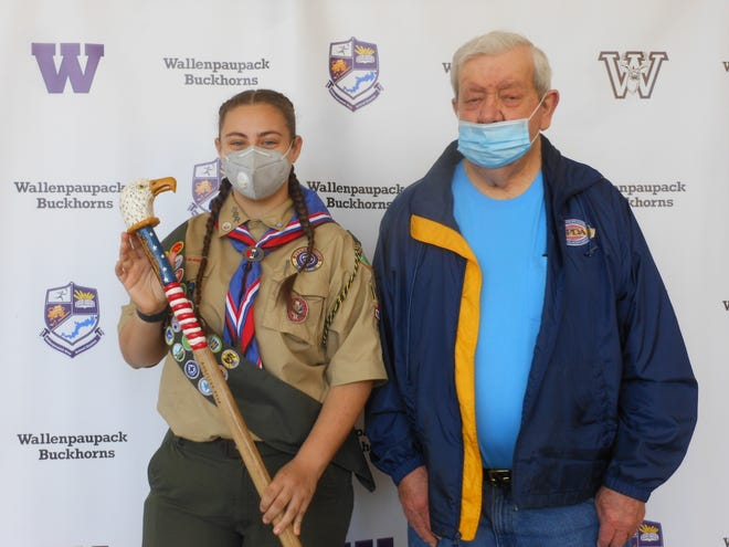 From left: Eagle Scout Angelina Krug, and William Roberts who presented her with this walking stick on May. He carved the cane for her, in appreciation for her story of achievement.