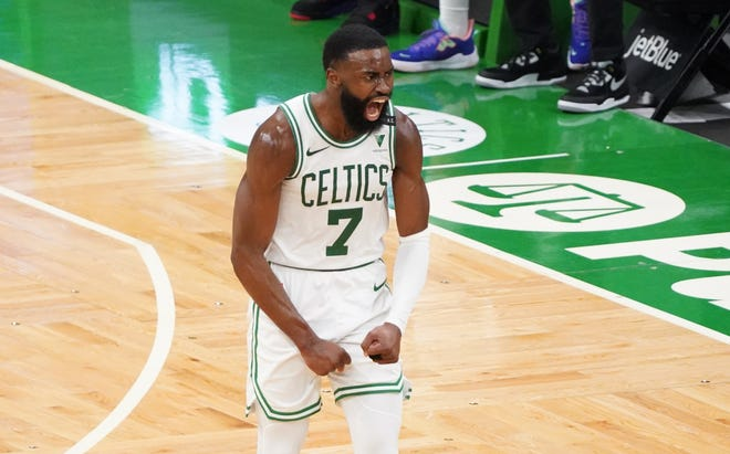Boston Celtics guard Jaylen Brown (7) reacts after his three point basket against the San Antonio Spurs in the third quarter at TD Garden on April 30, 2021