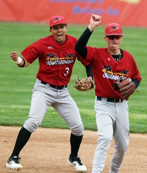 Southeastern Community College's Carlos Medina (3) reacts after teammate Tucker Cole (2) turns a double play during the first game of their Region XI baseball tournament game against DMACC Monday May 10, 2021 at Community Field.