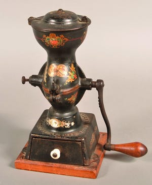 This strange looking cast-iron tool is a coffee grinder. Beans go in the top, the lid is put in place and the beans are ground and drop into the lower section mounted on a wooden base. It sold for $413 a few years ago.