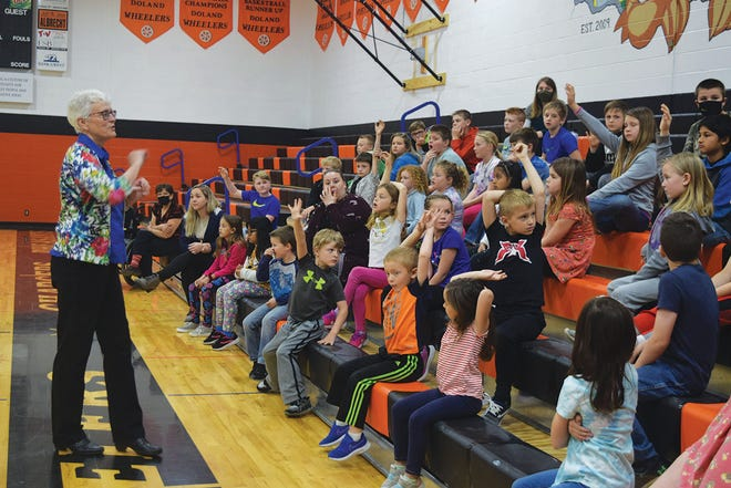 Angela Ehlers, executive director of the South Dakota Association of Conservation Districts, interacts with students.