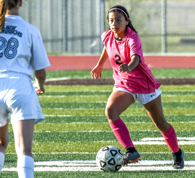 Garden City High School's Andrea Aguilar dribbles the ball upfield in a game earlier this season against TMP at Buffalo Stadium.