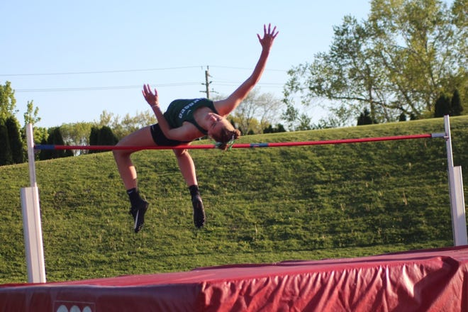 Annie Wirth set a school record in the high jump at the meet in Rock Island.