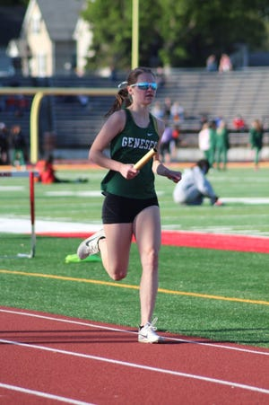 GHS Esther Brown ran the anchor leg in the 4 x 800 relay at the ABC Girls' Track competition in Rock Island.