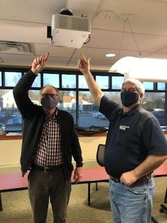 """Steve Emmerson, left, Hammond-Henry Hospital Foundation president; and Michael Keim, Foundation board treasurer, are shown with one of the three new projectors purchased for three conferences in the hospital. The projectors were purchased with $15,000 from Endowment Funds. Darcy Hepner, Foundation manager, said, """"The technology and quality that come with the projectors is quite an upgrade. Not only do the projectors benefit hospital employees, but also benefit community members that will use the conference rooms in the future as Covid retractions allow."""