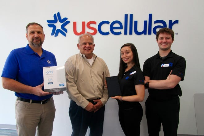 Paul Backe, left, Ed Garcia, owners of the recently-opened US Cellular Store in Geneseo; Shaina Hampton, store manager, and Austin White, assistant manager, were at the ribbon cutting for the new store.