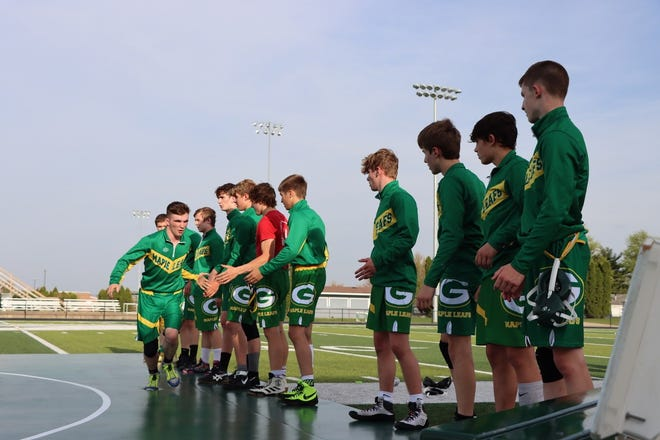 """Logan Tuggle gets """"high fives"""" from teammates as he is announced for the first """"Grapple on the Gridiron."""""""