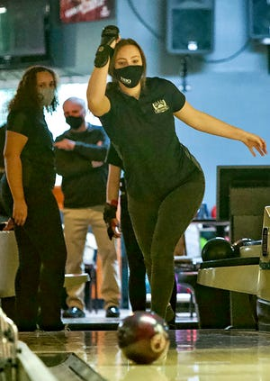 Galesburg High School senior Casey Folger follows through on her shot during the Silver Streaks' match with Rock Island on Wednesday Feb. 3, 2021 at Abbe Lanes in Abingdon.