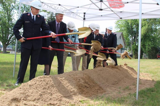 Board members participate in a groundbreaking ceremony at the Salvation Army of Holland in 2017. The significantly expanded facility has reopened and will celebrate with an open house event Wednesday, May 12.