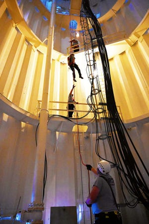 Morehead City Fire Department teamed up with Atlantic Beach Fire Department and spent several days sharpening their technical rescue skills. They are pictured rappelling down the inside of the Atlantic Beach water tower.