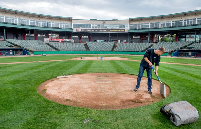 Assistant groundskeeper Jeremy Doty preps the pitcher's mound Monday, May 10, 2021 at Dozer Park. The Chiefs take on the Wisconsin Timber Rattlers in the home opener Tuesday night.