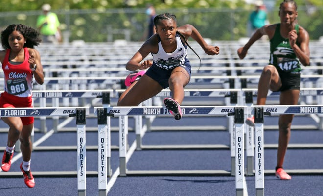 McKeel's Chelsi Williams clears the last hurdle as she wins the girls 100 hurdles recently at the 2021 FHSAA Class 2A State Track and Field Finals at the University of North Florida.