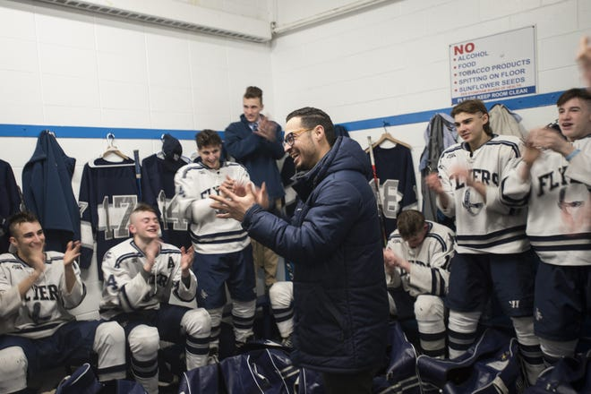 Framingham head boys hockey coach Will Ortiz III talks with the Flyers in the locker room after they defeated Reading 3-2 in double overtime, during the Div. 1A Super 8 play-in game at the Stoneham Arena, Feb. 23, 2020. The Flyers beat the Rockets, 3-2, in double overtime.