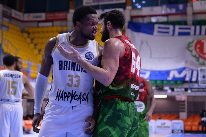 Milan graduate Nick Perkins has words with an opponent in the Italian Basketball Champions League. Perkins is averaging 13.2 points and 6 rebounds a game for a team that is second in the 15-team league.