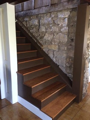 Stone from the 1790 part of the home can be seen on the stairway to the basement. Photo courtesy of the Hayford family