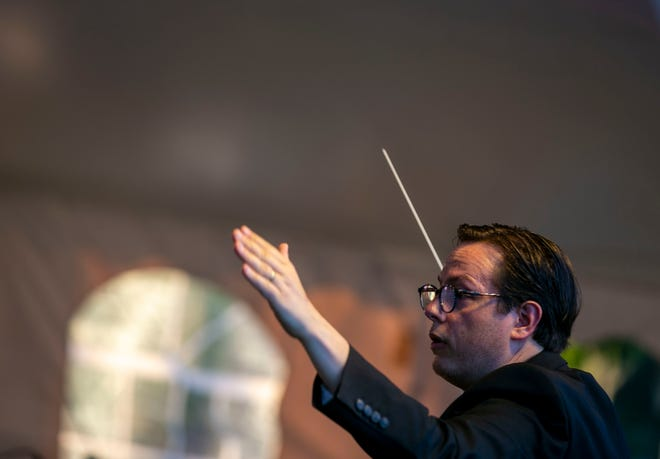 Conductor Matthew Wardell leads the Ocala Symphony on May 9 played during the annual Fine Arts For Ocala Symphony Under the Stars event at the Ocala Golf Club.