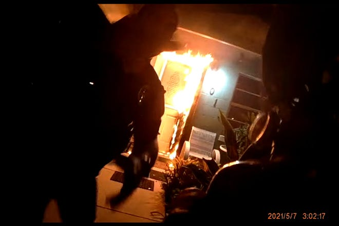Ocala police officers rescued a woman trapped inside her burning home by kicking in the back door Friday, May 7, according to an Ocala Police Department report.