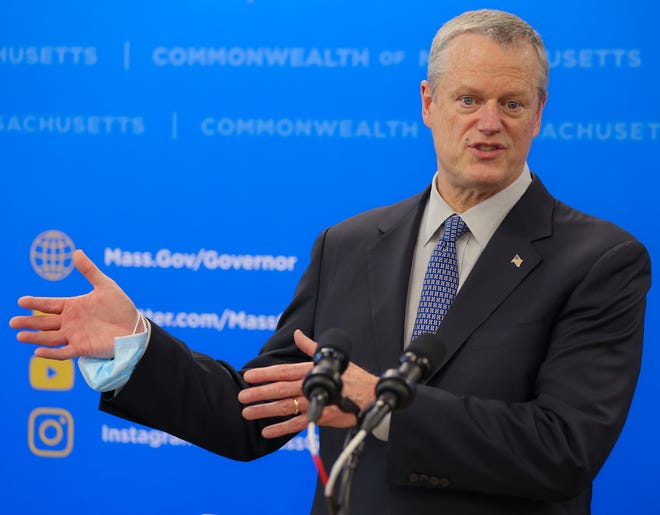 Gov. Charlie Baker speaks during a press conference at the Manet Community Health Center Vaccination Site in Quincy.