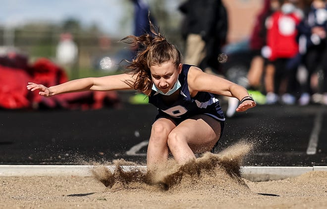 Petoskey's Alynna Himebaugh hits the sand pit in the long jump during the Red Hawk Invite on Saturday. Himebaugh had a new PR in the event.