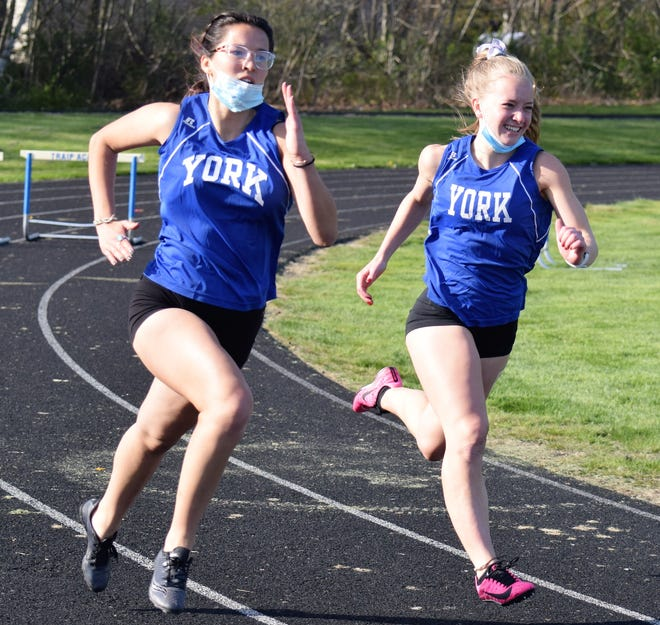 York's Olive Gaetano, left, and Charlotte Williamson approach the next hurdle during the 300-meter hurdles at Friday's meet at Traip Academy.